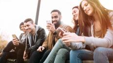 Millennial Friends On Smart Phones